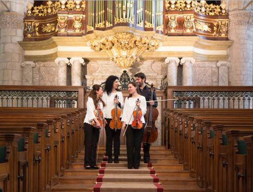 Members of the INGUZ quartet in a church